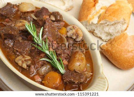 Beef bourguignon served with crusty French bread baguette.
