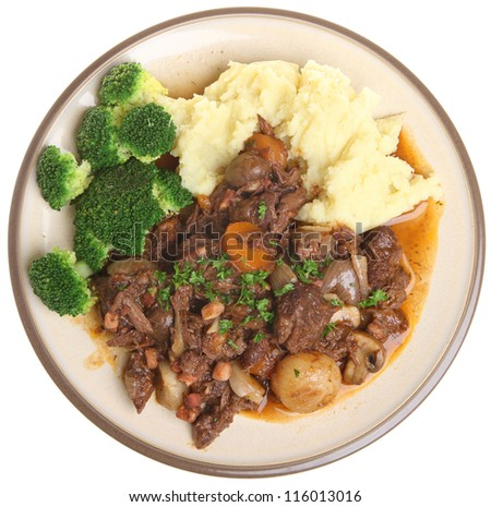Beef bourguignon stew dinner with mashed potato and broccoli.