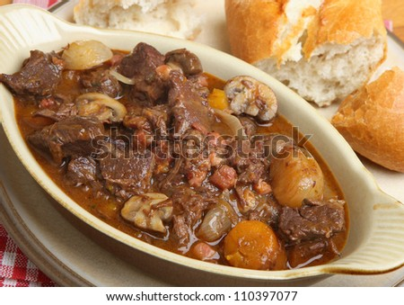 Beef bourguignon stew served with crusty bread.