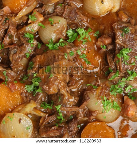 Beef bourguignon stew with carrots, shallots and mushrooms.