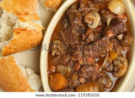 Beef bourguignon stew with crusty bread.