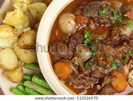 Shutterstock Beef bourguignon stew with fork-crushed new potatoes and asparagus.