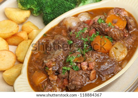 Beef bourguignon stew with roast potatoes and broccoli