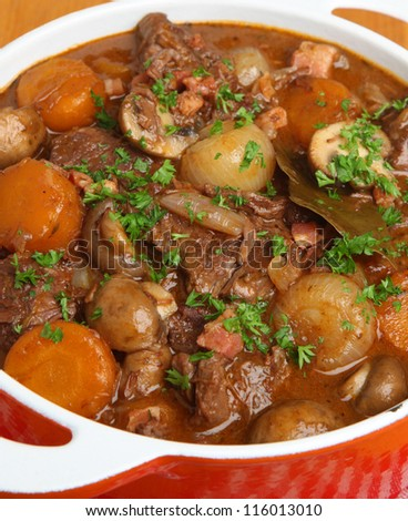 Beef bourguignon stew with shallots, mushrooms, lardons and carrots.