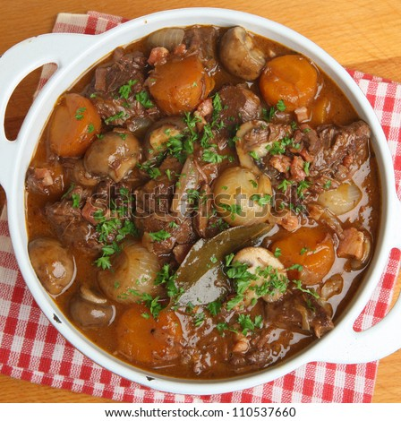 Beef bourguignon, traditional French stew, in casserole dish.