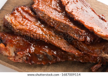 Beef brisket Barbecue. Picnic BBQ table spread. Beef brisket, chicken, pork ribs, beef ribs, Mac n cheese, coleslaw, and beer. Classic traditional Texas bbq meats and side dishes.