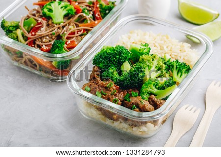 Beef Broccoli Stir Fry Meal Prep lunch box container on gray stone background