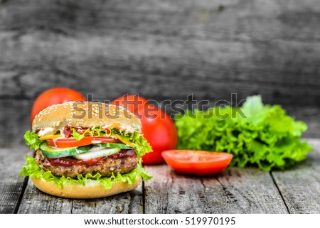 Beef burger, hamburger with grilled meat and vegetables, sandwich, takeaway food