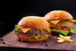 Beef burgers with french fries, beef cutlet, cheese, sauce