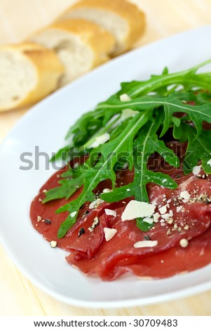 Beef carpaccio with pepper, rucola and parmesan