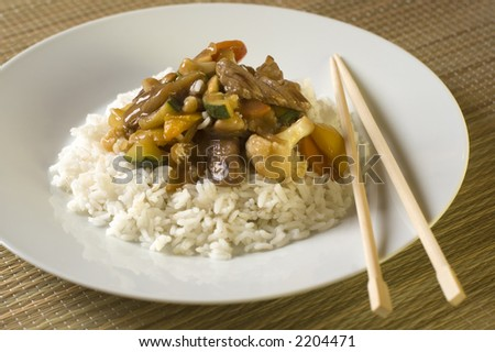 stock photo : beef china food gravy with rice on white plate