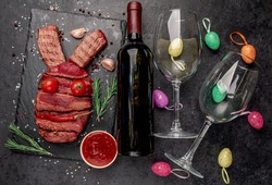 Beef Easter Bunny, bottle of wine and glasses on a stone background with copy space for your text. Easter celebration concept