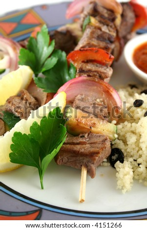 Beef kebabs and currant couscous with harissa sauce.