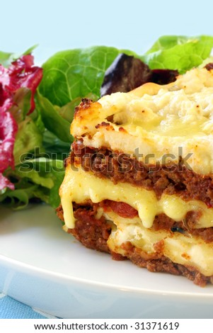 Beef lasagne with melting mozzarella and ricotta cheeses, with a salad.