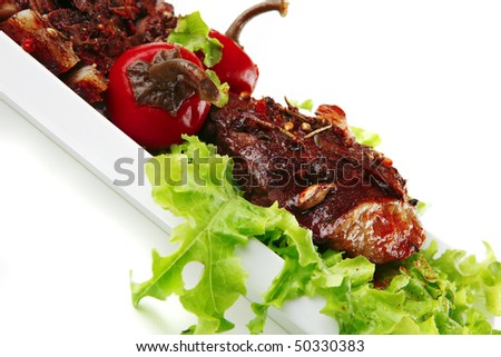 beef meat served with salad on white background