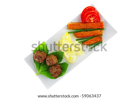 beef meatballs and basil with tomatoes and potatoes