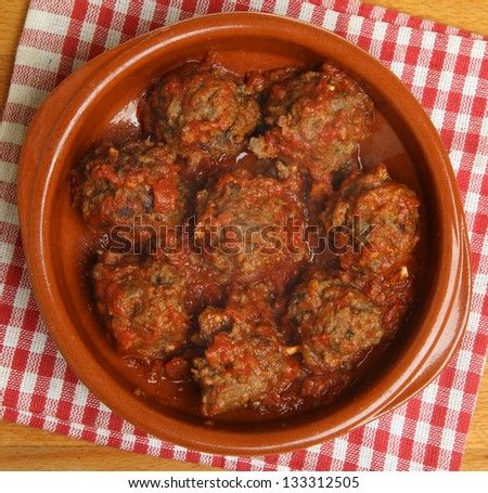 Beef meatballs in tomato sauce.
