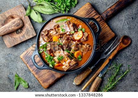 Beef ribs Bourguignon. Beef ribs stewed with carrot, onion in red wine. France dish
