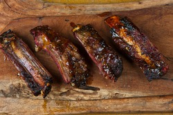 Beef Ribs. Traditional classic Texas Barbecue staple. Beef ribs seasoned in a dry rub and slow cooked in a smoker over mesquite woods chips.
