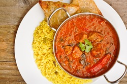 Beef Rogan Josh a popular indian curry with red pepper and spinach top view