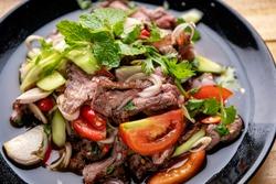 Beef salad,Spicy salad of roasted beef, Thai style food,Thai beef salad spicy dish.
