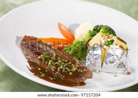 beef sirloin steak, sirloin steak with brown pepper sauce and baked potato