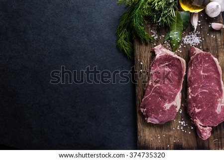 Beef sirloin steaks , on wooden board. Food border background, copy text space.