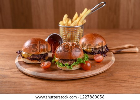 Beef Sliders with Chicken, Lettuce, Melted Cheese, French Fries, Ketchup