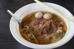 Beef soup and noodles, street food that is easy to find and have in a cafe beside the road in Thailand throughout the kingdom. It's called Kuay Tiew, and is very popular since noodle soup is tasty