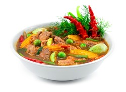 Beef Spicy Red Curry Spring Soup with Herbs Thai Food Local Style decorate with carving chili and vegetables sideview