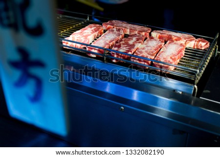 """Beef Steak Cooking on Bbq Grill Oven. Street Food Vendor In Taiwan.Taiwanese word in picture are """"Match formula"""""""