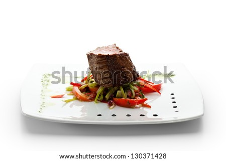 Beef Steak on Fresh Salad Leaf with Pesto Sauce