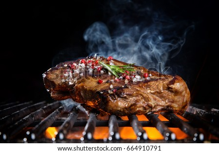 beef steak on the grill grate ...