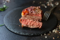 beef steak ribeye grilled veal meat juicy and fried rare or medium on the table tasty serving size portion top view place copy space for text