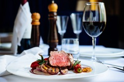 Beef steak with grilled vegetables served on white plate