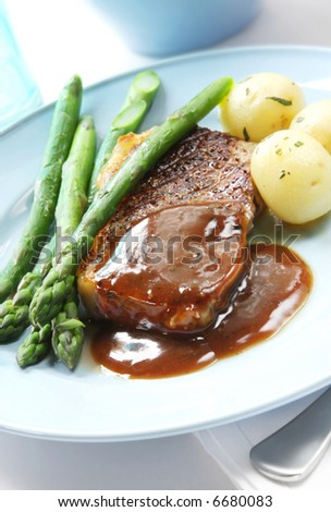 Beef Steak With Peppercorn Sauce Baby Potatoes And Asparagus