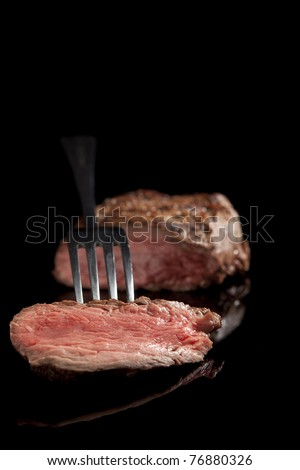 beef steak with salad and beans isolated on black background.