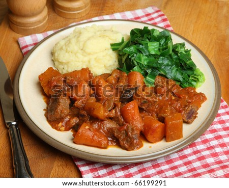 Beef stew with mashed potatoes and spring greens.