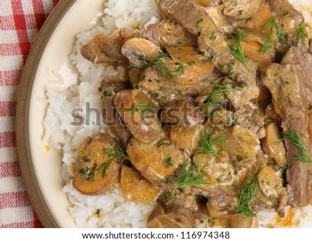 Beef stroganoff with rice. - stock photo