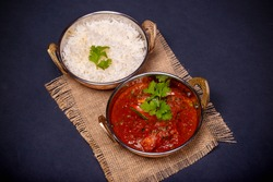 Beef Vindaloo, Brits style beef and potato curry served with option of mashed potato or steamed rice