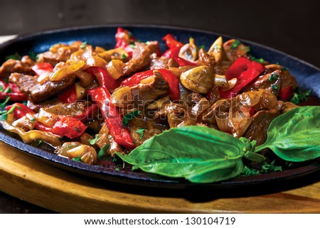 Beef with sauce. Beef, paprika, mushrooms, onion & sauce marinade