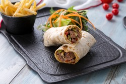 beef wrap , beef burrito beef roll, lamb wrap , lamb burrito lamb roll  on the wooden background