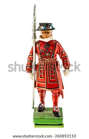 Beefeater statuette (Yeomen Warders of Fortress Tower of London) in Tudor State Dress isolated over a white background