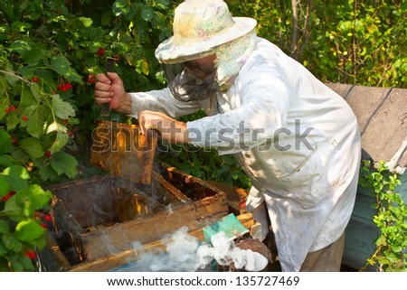 Beekeeper has control over a framework with honey