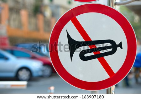 beeping prohibited sign for autos as no horn blowing
