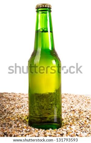 Beer and beach sand, studio shot