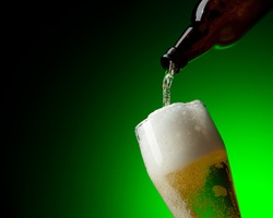 beer and bottle in dynamic on a green background