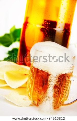 beer and chips on the background of a plastic bottle