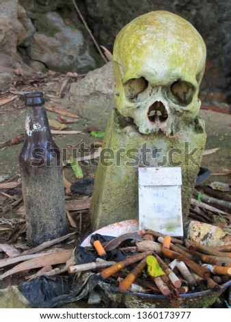 Beer and cigarettes brought as offerings to a dead person