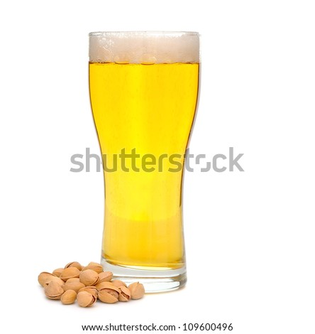 Beer and nuts on white background